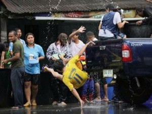 A man tumbles from a pickup during Songkran in Phang Nga