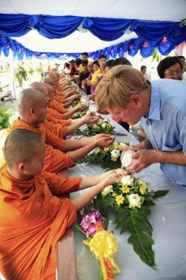 Another charming Songkran tradition is showing gratitude and respect to monks by pouring scented lustral water over their hands.