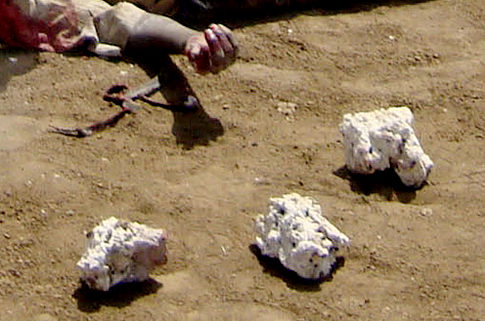 They then rained down blows on his body and finished him off by hitting him with stones.