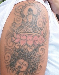 the tattoo of a Buddha seated on a lotus flower was spotted on her right arm