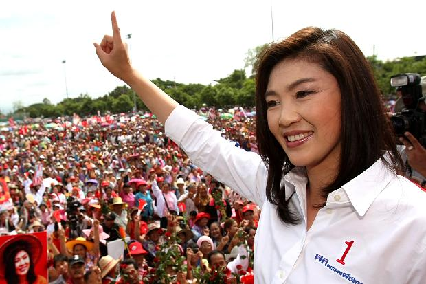 Supporters of Yingluck Shinawatra's administration have vowed to rise to defend her if the country's legal institutions eject her from office via two cases due to conclude in the next few weeks.
