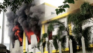 Smoke and flames billow from a factory window in Binh Duong, Vietnam, on Tuesday as anti-China protesters set more than a dozen factories on fire.