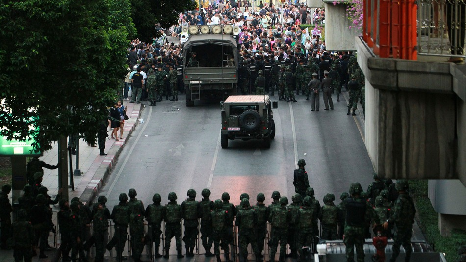 Thailand-coup-protest Protesters, background, confront Thai soldiers