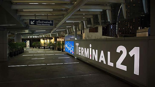 A usually crowded area at the airport in Bangkok, empty after a curfew was imposed