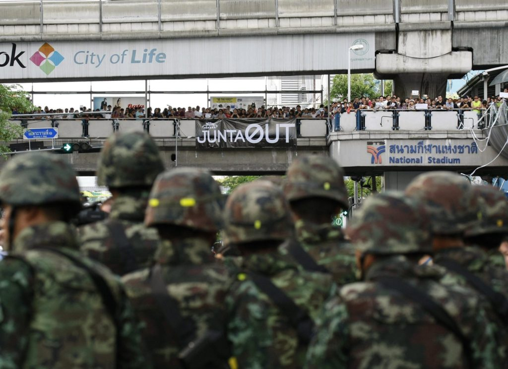 Soldiers stand guard as hundreds of pro-democracy activists held a demonstration against the army coup in front of the Bangkok Art and Culture Center (BACC) in center of Bangkok,