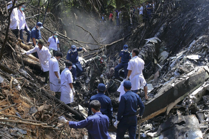 Laos air force plane crashes, defence minister reported dead.