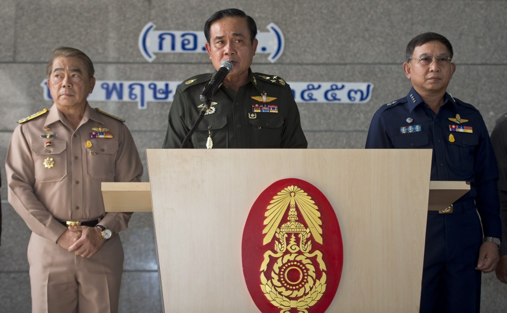 Thai Army chief General Prayut Chan-O-Cha (C) speaks next to Navy chief Narong Pipatanasai (L) and Air Chief Marshal Prajin Jantong (R) during a press conference at the Army Club in Bangkok