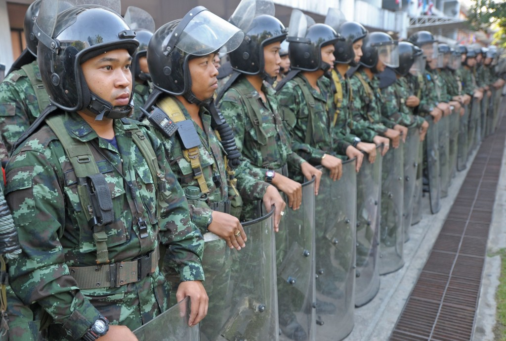 Thai soldiers stand guard at a key government building in Bangkok