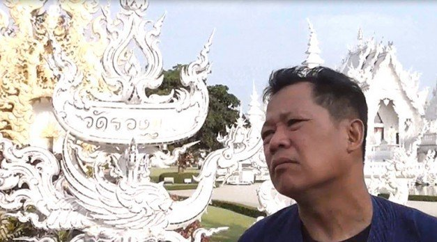 Artist Chalermchai Kositpipat says closing announcement was a publicity stunt to test the government