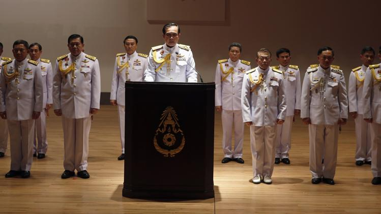 Thai Army chief General Prayuth Chan-ocha (C) is accompanied by his officers as he addresses reporters at the Royal Thai Army Headquarters in Bangkok