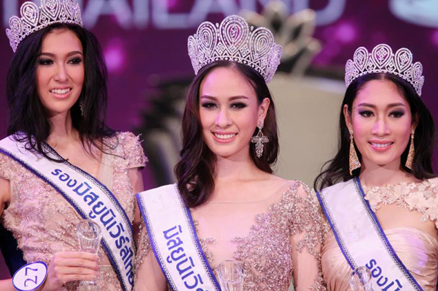 "Weluree ""Fai"" Dissayabut, centre, is crowned this year's Miss Universe Thailand. Flanking her are, left, first runner up Pimbongkot ""Ellie"" Jankaew and second runner-up Sunannipa ""Namphet"" Krissanasuwan. (Photos by Pattarachai Prechapanich)"