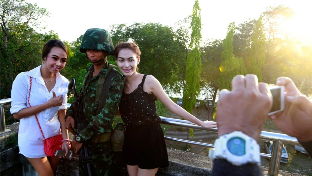 """Thailand Military Tries to Put Happy Spin on Coup """"Return Happiness to Thailand"""""""