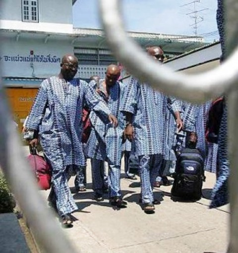 Serving time: Nigerian prisoners leaving the Bang Kwang Central Prison in Thailand to return to Nigeria where they will complete their remaining jail sentence