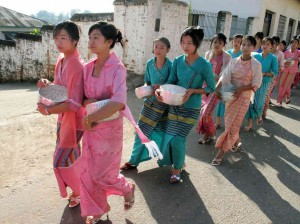 Women in Kengtung participate in a procession to a local monastery
