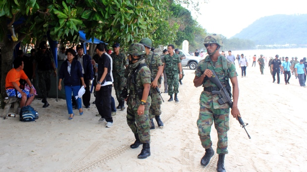 More than 100 troops trudged past surprised tourists along the white sands of Patong Beach on the popular southern island of Phuket to evict vendors who for years have cluttered the wide beach, making it nearly impossible to walk in some areas.