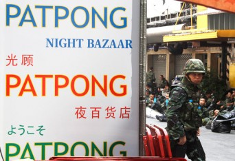 A Thai army soldier stands guard in the Patpong area