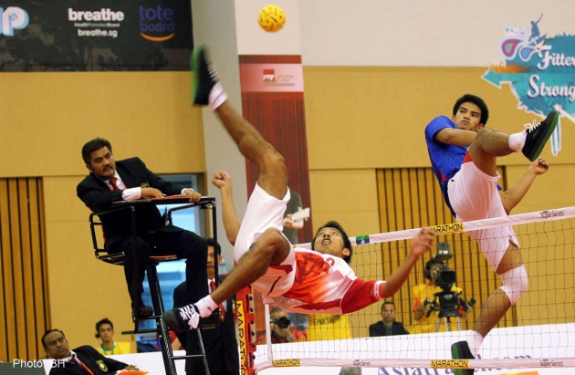 Thailand's sepak takraw player Pornchai Kaokaew (in blue) attempting to block a strike made by an Indonesian sepak takraw player during the final of the International Sepak Takraw Federation (Istaf) Super Series held at the ITE College East Simei in Singapore - See more at: http://news.asiaone.com/news/sports/thailand-will-win-9-or-10-gold-olympic-committee#sthash.IktAsbJr.dpuf