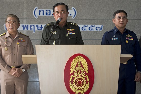 Prajin Juntong, at right of Thai junta leader Gen. Prayuth Chan-ocha in Bangkok on May 20, has been tasked with luring foreign investment to the country in his role as economics czar