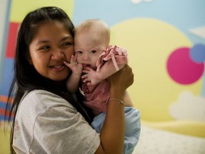 Thai surrogate mother Pattaramon Chanbua (L) holds her baby Gammy,