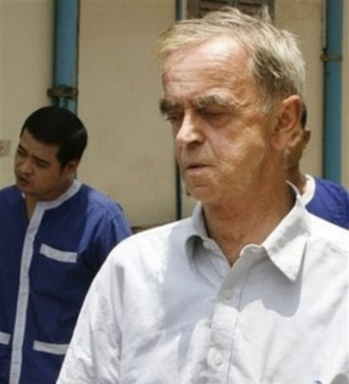 Olaf Achleitner, of Austria, stands in the Phnom Penh Municipality Court in Phnom Penh, Cambodia