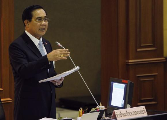 Thai Army chief General Prayuth Chan-ocha speaks during the start of a National Legislative Assembly meeting to consider urgent matters including the 2015 Budget Bill, at the parliament in Bangkok August 18, 2014.