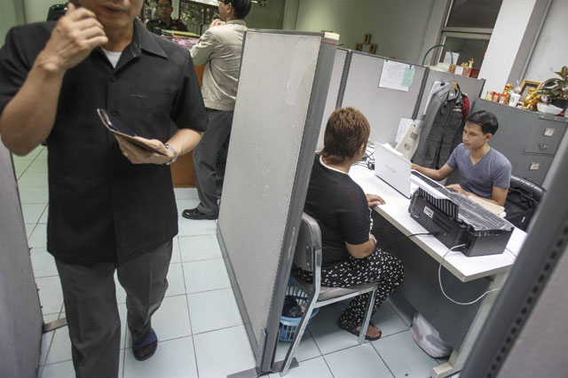 A woman, identified as a surrogate mother, testifies at Lumpini Police Station in Bangkok