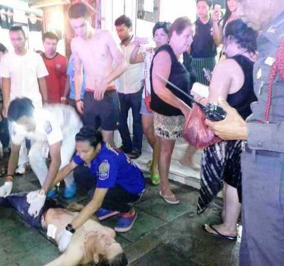 Australian tourist Dwayne House lies on the ground in agony after being stabbed in the abdomen with a broken bottle. Photo: Thawit Bilabdullar - See more at: http://www.phuketgazette.net/phuket-news/Australian-tourist-stabbed-Patong-street-fight-Thai/36030#sthash.W87IKwlT.dpuf