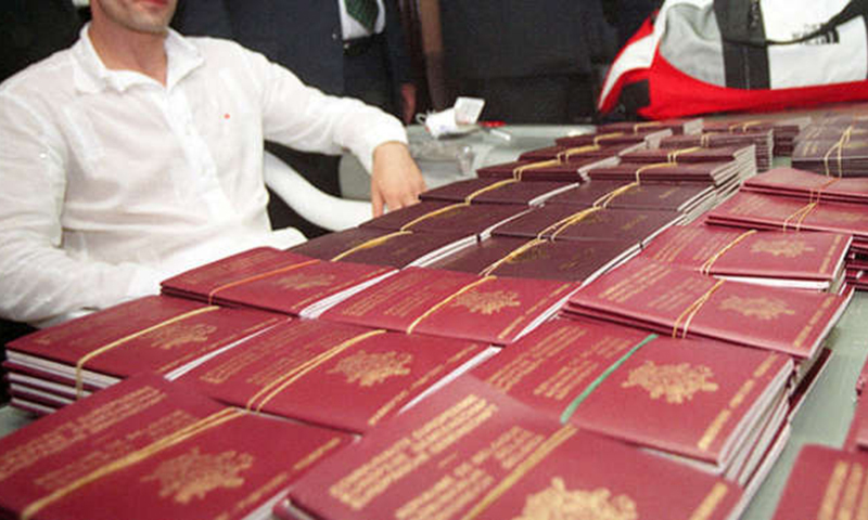 The image shows forged passports recovered by authorities in Thailand.