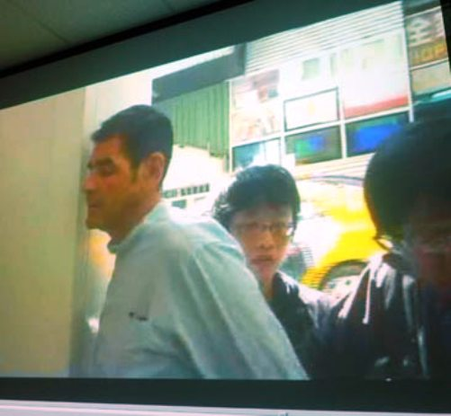 French National Eric Jacobs being escorted by Court Officials