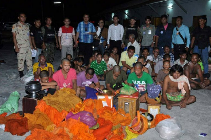 Twenty-eight Thai men have been arrested for posing as monks and temple assistants to collect donation money that they allegedly used for gambling, pornography, and narcotics, 4 Sept 2014.