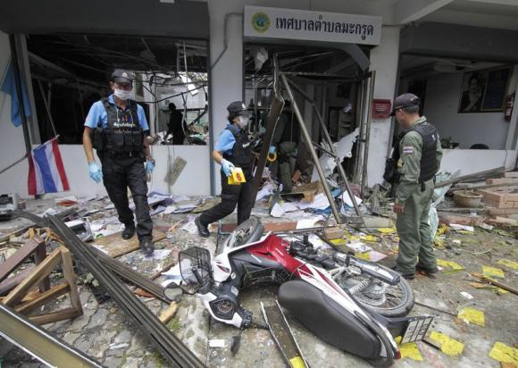 Security personnel inspect the Kok Po district office after being attacked by a group of gunmen in Pattani province