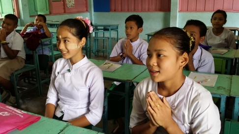 "Many students are from Myanmar (as seen in the traditional ""Thaka"" facepaint)."