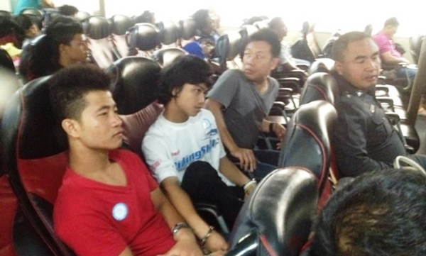 Murder suspects Zaw Rim, red-shirt left, and Win are taken to Koh Samui to await a court appearance later this week. SUPAPONG CHAOLAN