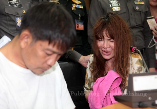 Somchai Kaewbangyang, left, and Pornchanok Chaiyapa, right, appear before the media at the headquarters of the Metropolitan Police Bureau Thursday after the discovery of the body parts of 79-year-old Japanese teacher Yoshinori Shimato. CHANAT KATANYU