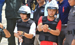 The two suspects, named only as Saw (left) and Win (right) take part in a reconstruction of their alleged crime. Photograph: Bangkok Post/Barcroft Media