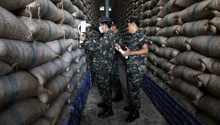 Soldiers inspect rice holding facility in Northern Thialand
