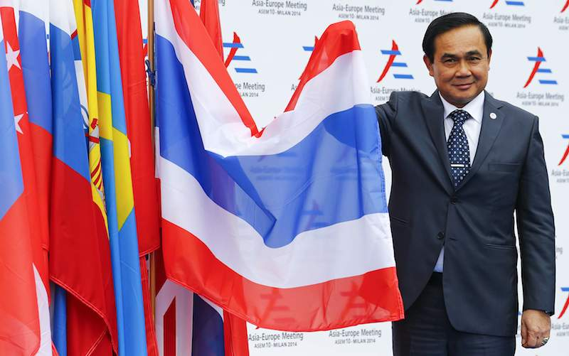 Thailand's Prime Minister Prayut Chan-o-cha poses as he arrives for the Asia-Europe Meeting (ASEM) in Milan