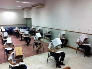 Thailand's Civil Aviation Center allegedly used a similar anti-cheating approach. A photo (also posted on Facebook) shows students wearing cardboard boxes on their heads.