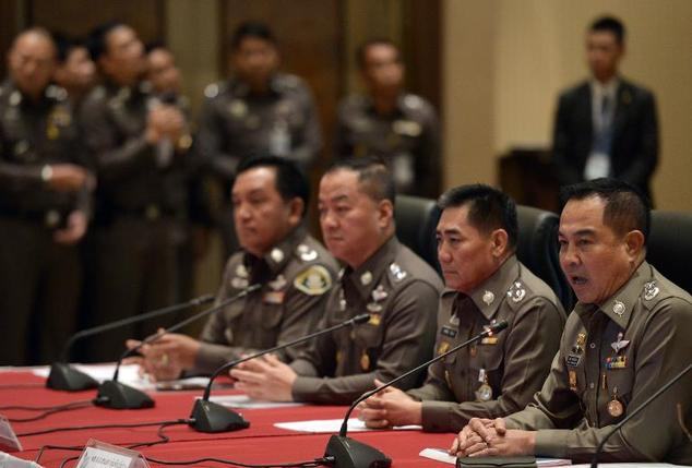 Thai national police chief Somyot Poompanmoung (R) addresses reporters during a press conference