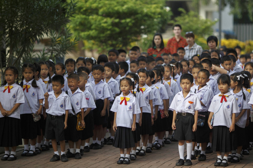 Students sing Thailand's national anthem at a school in Bangkok