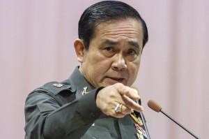 """Thailand's Prime Minister Prayuth Chan-ocha threatened to tighten controls of the media unless they stop """"presenting news"""" about former premier Thaksin Shinawatra"""