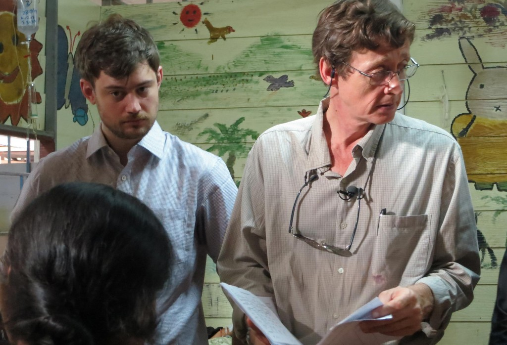 Dr. Francois Nosten, right, consulting staff as he meets malaria patients at a clinic near Mae Sot.