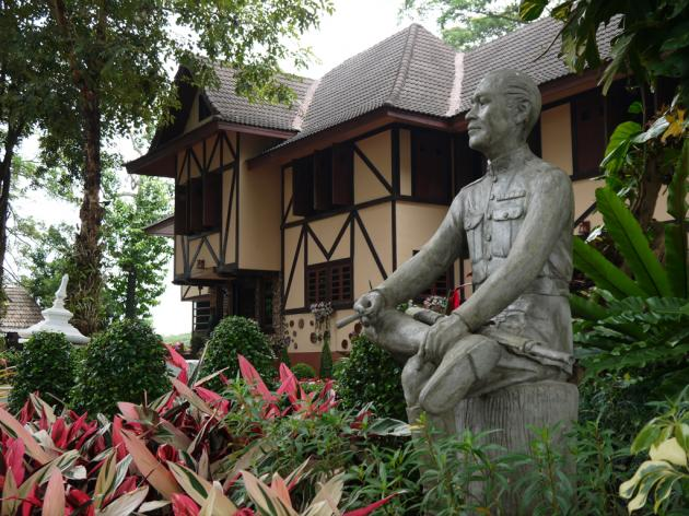 A statute of Field Marshal Field Marshal P Pibulsongkram stands against his Swiss-style chalet in Chiang Rai.