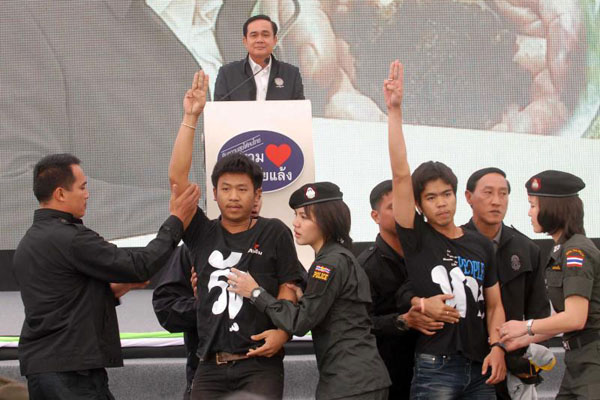 Khon Kaen University students protest against the May 22 coup in front of Gen Prayut Chan-o-cha's stage at the Khon Kaen