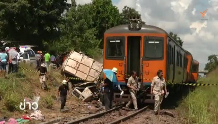 Four people, including the train driver, died and 20 others injured when a third class passenger train crashed into a ten wheel truck at a railway crossing in Khon Kaen province