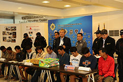 Ten members of a drug gang are presented at a press conference at the Office of the Narcotics Control Board (ONCB) headquarters with 12 of crystal methamphetamine, worth 12 million baht. (ONCB photo)