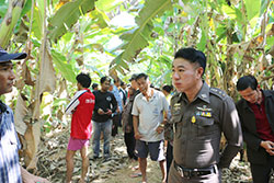 Police question local residents after the murder of the husband of a local leader whose emasculated, naked body was foundin a banana orchard. (Photo by Sitthipoj Kebui)