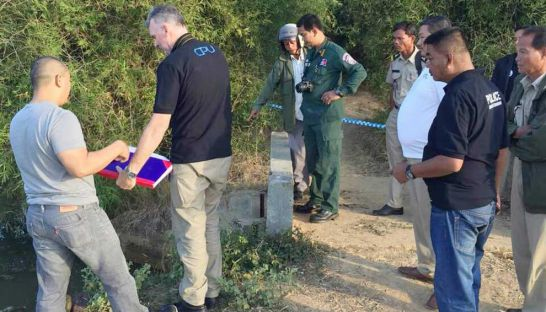 Police and members of the Child Protection Unit inspect a waterway in Kampong Speu's Samrong Tong district over the weekend after a young girl's body was found