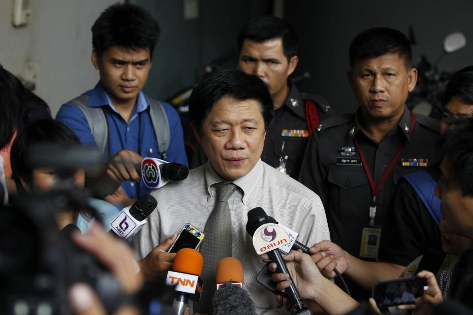 Chief of the Forensic Police Institute Pornchai Suteerakune updates reporters on the deaths of
