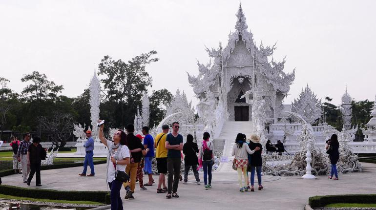 """Tourists visiting Wat Rong Khun, the """"White Temple"""", one of the top tourist destinations in Chiang Rai"""